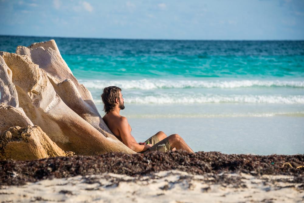 Boy meditating by ocean