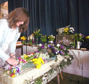 Decorating a coffin at friend's funeral