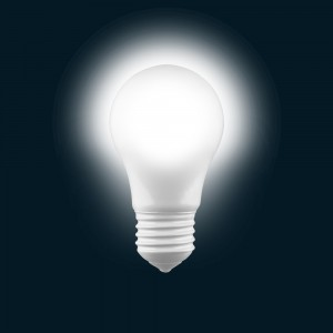 Electric light bulb in dark blueness